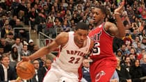 Rudy Gay (22) of the Toronto Raptors drives to the basket on Mario Chalmers in last Sunday's 100-85 loss to the Miami Heat. (Ron Turenne/Getty Images)