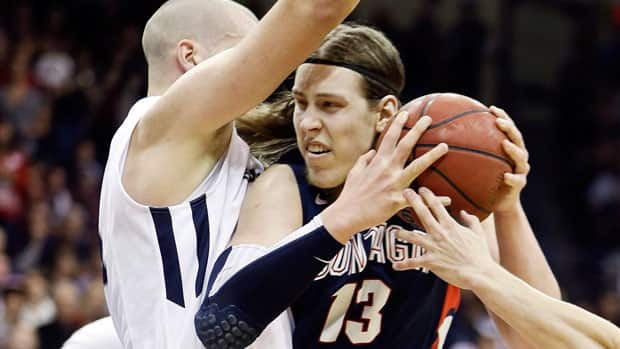 Seven-foot Canadian Kelly Olynyk, right, has blossomed into one of the top players in U.S. college basketball and a leader of the No. 1-seeded Gonzaga Bulldogs. (Lenny Ignelzi/Associated Press)