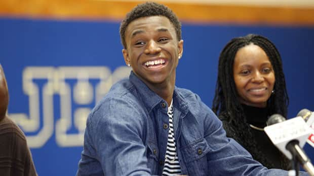 Canadian basketball star Andrew Wiggins, alongside his mother, Marita Payne-Wiggins, announced his commitment to the University of Kansas on Tuesday in Huntington, W. Va., where he attends high school. (Holten Singer/The Herald-Dispatch/Associated Press)