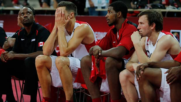 Canada's Levon Kendall, centre, reacts moments before his team's elimination from the FIBA Americas Championship on Sunday. (Fernando Llano/Associated Press)
