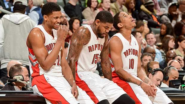 From left to right, Rudy Gay, Amir Johnson and DeMar DeRozan of the Toronto Raptors have their work cut out for them if they hope to lead the team to the playoffs this season. But that may not be their best course of action in the long run. (Ron Turenne/NBAE via Getty Images)