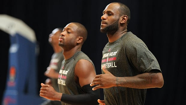 LeBron James, right, and Dwyane Wade of the Miami Heat during training camp on October 2, 2013 at Atlantis Resort in Nassau, Bahamas. (Issac Baldizon/NBAE via Getty Images).