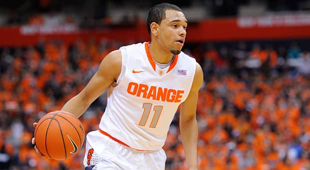 Syracuse point guard Tyler Ennis steered the Orange to a 27-5 record while averaging a team-high 5.6 assists per game. (Rich Barnes/Getty Images)