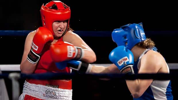 Canadian female boxer Mary Spencer, left, has the ability to create an instant legacy, not to mention personal wealth by winning the inaugural Olympic gold medal in her sport. (Andrew Vaughan/Canadian Press)