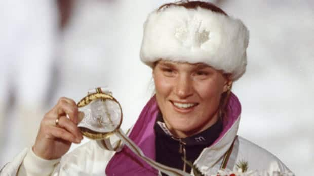 In this Feb. 1992 file photo, Canadian alpine skier Kerrin Lee-Gartner shows off her gold medal after winning the women's downhill race at the Olympic Games in Albertville, France. Lee-Gartner was the first Canadian to accomplish the feat. (Rick Stewart/Allsport)