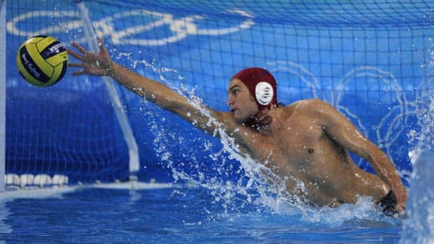 Canada's goalkeeper Robin Randall tries to stop the ball during a men's water polo competition.  His Olympic dream may be over.  (Fred Dufour/AFP/Getty Images)