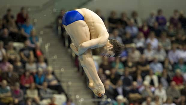 Alexandre Despatie competes in the men's three-metre springboard at the FINA Diving World Cup, an Olympic test event held at the Olympic Aquatic Centre in east London, England, on Feb. 21. (Miguel Medina/Getty Images)