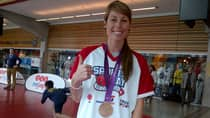 Vancouver's Emily Zurrer of soccer fame shows off her newly minted Olympic bronze medal at the BC Sports Hall of Fame.