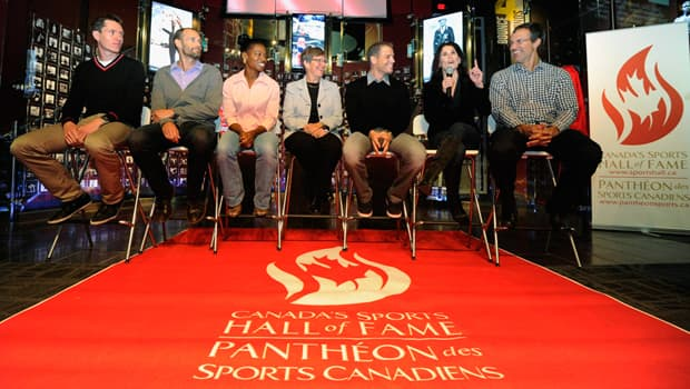 Jeremy Wotherspoon, left to right, Derek Porter, Charmaine Hooper, Marion Lay, David Pelletier, Jamie Sale and Scott Niedermayer attend Thursday's Canada's Sport Hall of Fame media conference in Calgary. (Larry MacDougal/Canadian Press)
