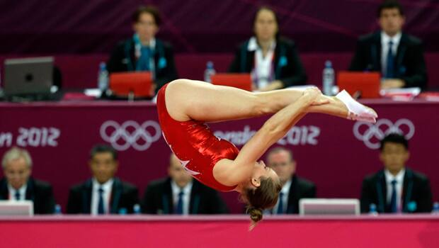 Reigning Pan Am Games champion Rosie MacLennan of King City, Ont., performs for the judges en route to winning the gold medal in women's individual trampoline final at the London Olympics on Aug. 3. (Julie Jacobson/Canadian Press)