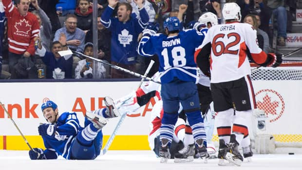 Toronto Maple Leafs' Frazer McLaren, left, celebrates scoring along with teammate Mike Brown as Ottawa Senators Eric Gryba, right, and Derek Grant look on during the first period action in Toronto on Saturday. (Chris Young/Canadian Press)