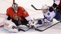 Toronto Maple Leafs forward Leo Komarov, right, attempts to score on Ottawa Senators goalie Ben Bishop during the second period in Ottawa on Saturday. (Sean Kilpatrick/Canadian Press)