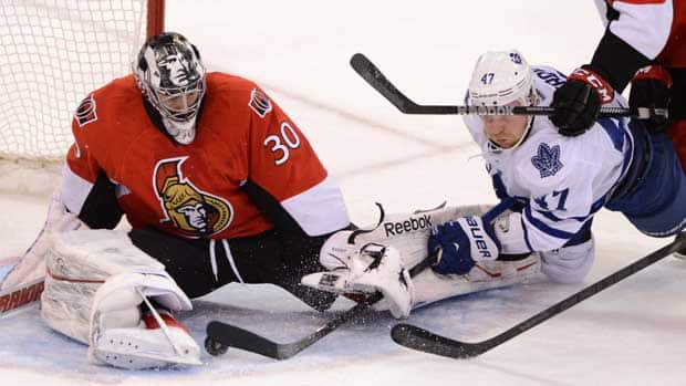 Toronto Maple Leafs forward Leo Komarov, right, attempts to score on Ottawa Senators goalie Ben Bishop during the second period in Ottawa on Saturday. (Sean Kilpatrick/Canadian Press)