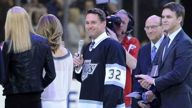 Former Los Angeles Kings goalie and Hockey Night in Canada commentator Kelly Hrudey is recognized at centre ice before the game against the Calgary Flames at the Staples Center on Saturday. (Harry How/Getty Images)
