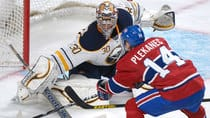 Buffalo Sabres goaltender Ryan Miller makes a save against Montreal Canadiens forward Tomas Plekanec during the third period in Montreal on Saturday. (Graham Hughes/Canadian Press)
