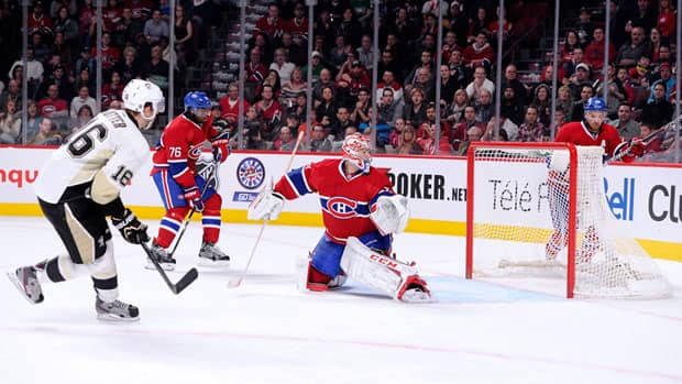 Pittsburgh Penguins' Brandon Sutter seals a wild one in overtime as he scores past Montreal Canadiens' Carey Price for a 7-6 victory Saturday.  (Richard Wolowicz/Getty Images)