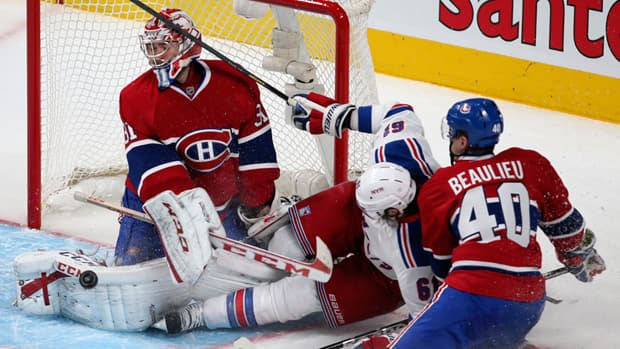 Montreal Canadiens goalie Carey Price, left, turned away 34 shots Saturday for his 19th career shutout. (Christinne Muschi/Reuters)