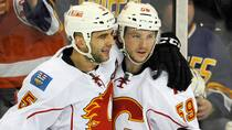 Calgary Flames' Max Reinhart, right, celebrates scoring his first career NHL goal with teammate Mark Giordano against the Edmonton Oilers on Saturday. (Dan Riedlhuber/Reuters)