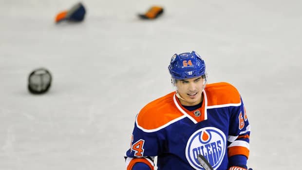 Hats litter the ice as Edmonton Oilers' Nail Yakupov celebrates his third goal to seal his hat trick against the Vancouver Canucks during the third Saturday. (Dan Riedlhuber/Reuters)