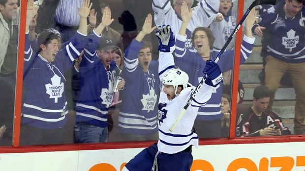 Toronto forward Joffrey Lupul celebrates his goal against the Ottawa Senators as Maple Leafs fans cheer the team's first playoff appearance in nine years. (Fred Chartrand/Canadian Press)