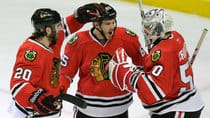Chicago Blackhawks centre Andrew Shaw (65) celebrates with teammates Brandon Saad (20) and goalie Corey Crawford (50) after defeating the Detroit Red Wings in Game 5 in Chicago, Ill. Saturday. (John Gress/Reuters)