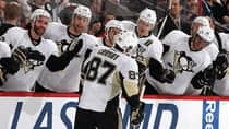 Sidney Crosby of the Pittsburgh Penguins celebrates his third period goal with teammates on the bench in Game 4 against the Ottawa Senators on Thursday. (Jana Chytilova/Freestyle Photography/Getty Images)
