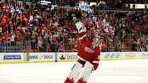 Red Wings goalie Jimmy Howard acknowledges fans after being named the first star of Detroit's 2-0 win over the Chicago Blackhawks in Game 4. (Gregory Shamus/Getty Images)