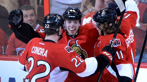 Ottawa Senators forward Jean-Gabriel Pageau, middle, celebrates a hat-trick and the sixth goal against the Montreal Canadiens during the third period at Scotiabank Place in Ottawa on Sunday. (Sean Kilpatrick/Canadian Press)