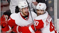 Detroit Red Wings' Brendan Smith, left, celebrates his goal with teammate Henrik Zetterberg against the Chicago Blackhawks during the second period in Game 2 of their semifinal matchup Saturday. (Jim Young/Reuters)
