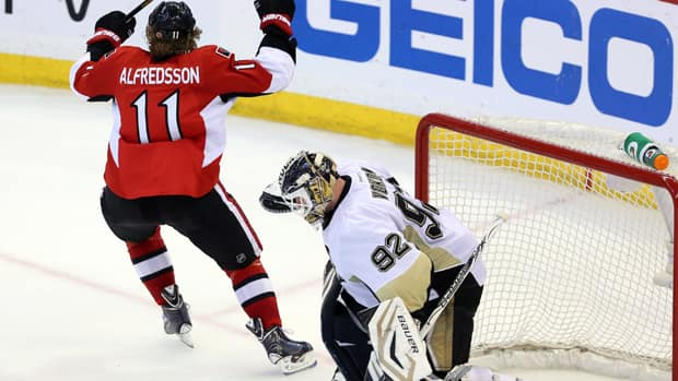 Ottawa Senators' Daniel Alfredsson (11) celebrates his tying goal against the Pittsburgh Penguins late in the third period Sunday night. Alfredsson's goal allowed the Senators to win Game 3 in double overtime. (Fred Chartrand/Canadian  Press)