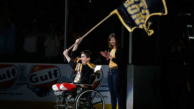 Boston Marathon bombing victim Jeff Bauman is honoured as the official flag-bearer before Game 2 of the Bruins and the Toronto Maple Leafs playoff series Saturday in Boston. (Elise Amendola/Associated Press)