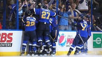 Members of the St. Louis Blues celebrate a 2-1 overtime win over the defending Stanley Cup champion Los Angeles Kings in Game 1 of the Western Conference quarter-final round Tuesday night. (Dilip Vishwanat/Getty Images)