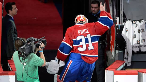 Montreal Canadiens goalie Carey Price (31) salutes the crowd after defeating the Ottawa Senators 3-1 in Game 2 Friday night. (Ryan Remiorz/Canadian Press)