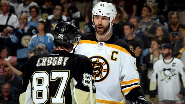Sidney Crosby (87) of the Pittsburgh Penguins and Zdeno Chara (33) of the Boston Bruins exchange words near the end of the second period of Game 1 at the Consol Energy Center on Saturday in Pittsburgh. (Bruce Bennett/Getty Images)