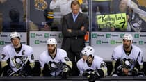 Some fans remain hopeful for the Pittsburgh Penguins as head coach Dan Bylsma stands behind the bench with Sidney Crosby, left, Pascal Dupuis (9), Tyler Kennedy and Craig Adams, right, during the third period of Game 4 of the NHL Eastern Conference final. (Brian Snyder/Reuters)
