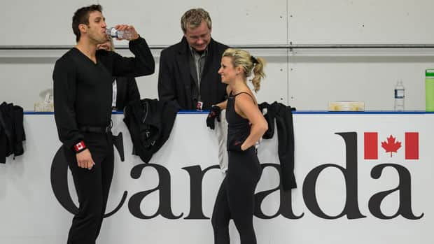 Figure skaters Dylan Moscovitch, left, and Kirsten Moore-Towers will be featured as part of CBC's Canada Day coverage. (Geoff Robins/AFP/Getty Images)
