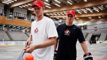 Eric Staal, left, balances a ball on his stick as his brother Marc Staal, right, looks on following a ball hockey training session at the Canadian national men's team orientation camp in Calgary on Tuesday. (Jeff McIntosh/Canadian Press)