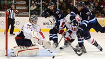 Washington Capitals goalie Braden Holtby deflects a shot from Winnipeg Jets forward Evander Kane, right, during the Kraft Hockeyville game in Belleville, Ont., Saturday. (Sean Kilpatrick/Canadian Press)