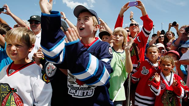 Young fans welcome Jonathan Toews, captain of the Chicago Blackhawks, when he brought the Stanley Cup to Winnipeg July 19, 2013. (John Woods/The Canadian Press)