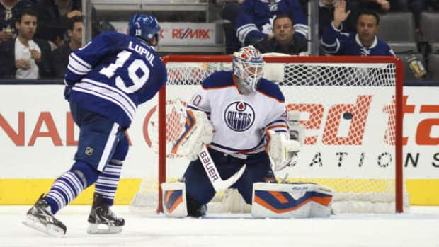 Toronto Maple Leafs forward Joffrey Lupul scores on Edmonton Oilers goalie Devan Dubnyk on Saturday. (Getty Images)