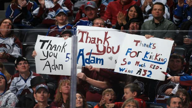 Fans thank former Colorado Avalanche defenceman Adam Foote ahead of his jersey retirement ceremony on Saturday. (Getty Images)