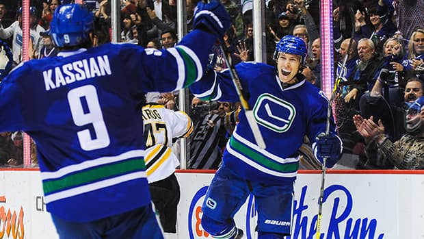 David Booth (7) of the Vancouver Canucks celebrates along with his teammate Zack Kassian (9) after scoring his team's second goal against the Boston Bruins on Saturday. (Derek Leung/Getty Images)