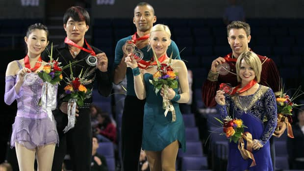 Aliona Savchenko and Robin Szolkowy of Germany (gold, center), Dan Zhang and Hao Zhang of China (silver, left) and Kirsten Moore-Towers and Dylan Moscovitch of Canada (bronze, right) hold up their gold medals after winning the Pairs competiton during Hilton HHonors Skate America at Citizens Business Bank Arena on October 23, 2011 in Ontario, California. (Photo by Stephen Dunn/Getty Images)