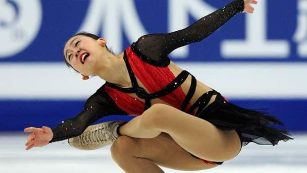 Japan's Mao Asada is set to unveil her retooled programs in her Grand Prix season debut in Sapporo. (Yuri Kadobnov/AFP/Getty Images)