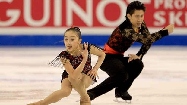 Sui Wenjing, front, and Han Cong dominated the pairs' competition en route to their third consecutive junior world title. (Matthew Stockman/Getty Images)