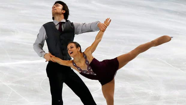 Eric Radford and Meagan Duhamel of Canada overcame a slow start in Paris to win silver on Saturday. (Michel Euler/Associated Press)