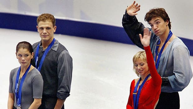 In this Feb. 11, 2002 file photo, figure skating pairs silver medal winners Jamie Sale and David Pelletier of Canada, left, look towards gold medal winners Elena Berezhnaya and Anton Sikharulidze of Russia during the awards ceremony at the Winter Olympics. The pairs judging scandal rocked the Salt Lake City Olympics, resulting in Sale and Pelletier going from silver to co-gold medallists a week later. (Doug Mills/Associated Press)
