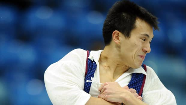 Patrick Chan left points on the table during a jump combination Saturday in Russia. (Yuri Kadobnov/Getty Images)