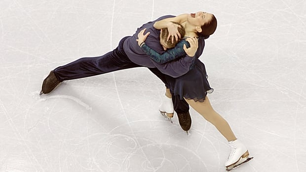 Canadian pairs skaters Jamie Sale and David Pelletier whoop it up after performing what proved to be the winning free program in the world figure skating championships at GM Place in Vancouver on March 21, 2001. (Brian Bahr/Getty Images)
