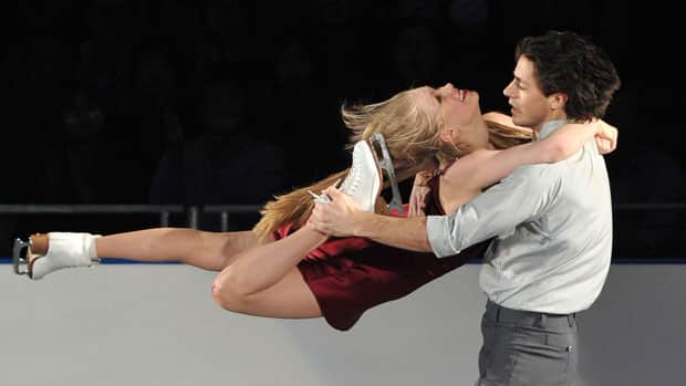 Kaitlyn Weaver, left, and Andrew Poje, right, helped Canmada capture the team silver at the World Team Trophy figure skating competition in Tokyo over the weekend. (Kazuhiro Nogi/ AFP/Getty Images)
